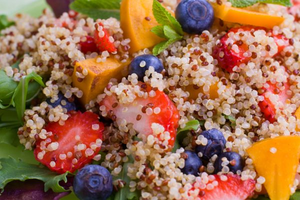 quinoa severed with strawberry and blueberry