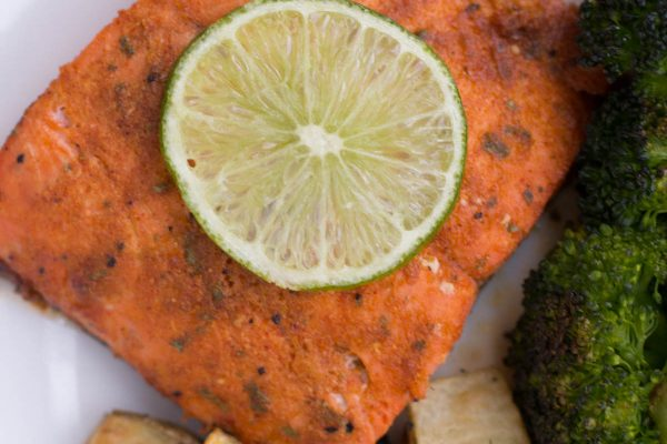 sutter buttes Cajun seasoned salmon with a lemon sitting on top