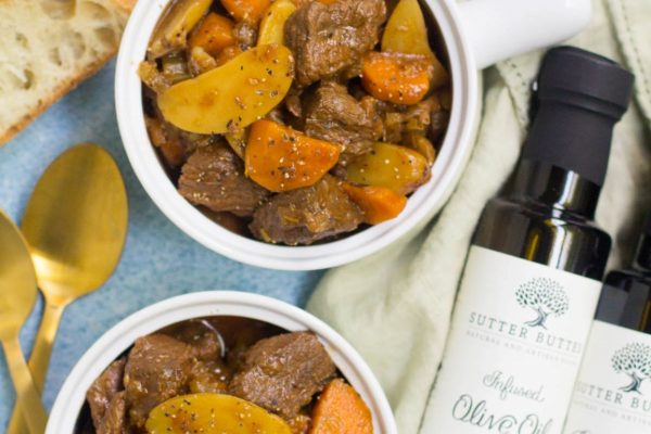 beef stew with sutter buttes olive oil and balsamic vinegar bottles laid on the side