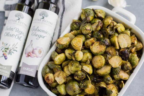 white balsamic brussels sprouts, with sutter buttes olive oil bottles laid next to the meal