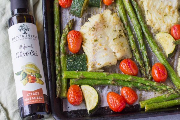 citrus habanero cod decorated with roasted tomato and asparagus